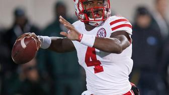 EAST LANSING, MI - OCTOBER 04: Tommy Armstrong Jr. #4 of the Nebraska Cornhuskers throws a second-quarter pass against the Michigan State Spartans at Spartan Stadium on October 4, 2014 in East Lansing, Michigan. (Photo by Gregory Shamus/Getty Images)