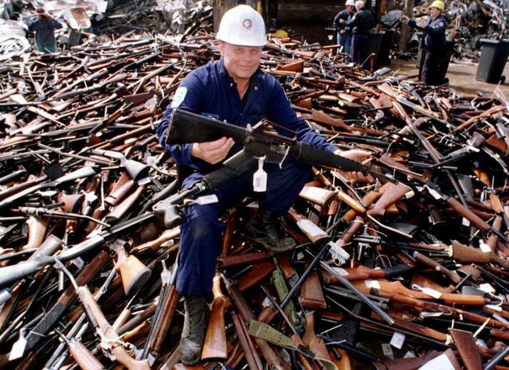 <span>A&nbsp;project supervisor with a local security firm holds up an armalite rifle similar to the one used in the Port Art