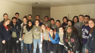 Muslim and Jewish students from New York University work together on a service trip project