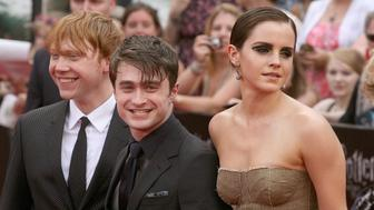 Actors Rupert Grint, Daniel Radcliffe and  Emma Watson attend the premiere of 'Harry Potter and the Deathly Hallows - Part 2' at Avery Fisher Hall, Lincoln Center on July 11, 2011 in New York City.