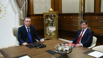 <p>Turkish Prime Minister Ahmet Davutoglu meets with President Recep Tayyip Erdogan in Ankara, Turkey, on Aug. 28, 2015.</p>