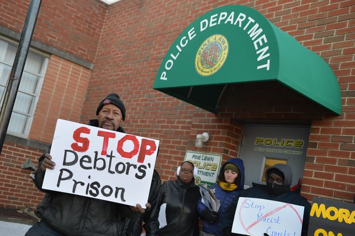 Protesters gather outside the Pine Lawn Police Department in Missouri.