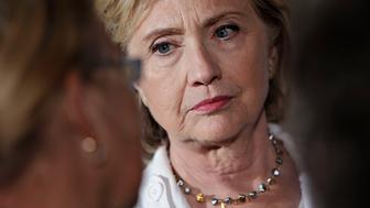 Hillary Clinton, former U.S. secretary of state and 2016 Democratic presidential candidate, listens to attendees during an organizing event in Baldwin, Iowa, U.S., on Wednesday, Aug. 26, 2015. Clinton is emphasizing investment in small towns to help strengthen rural America as part of a plan released after she was endorsed by U.S. Agriculture Secretary Tom Vilsack. Photographer: Daniel Acker/Bloomberg via Getty Images
