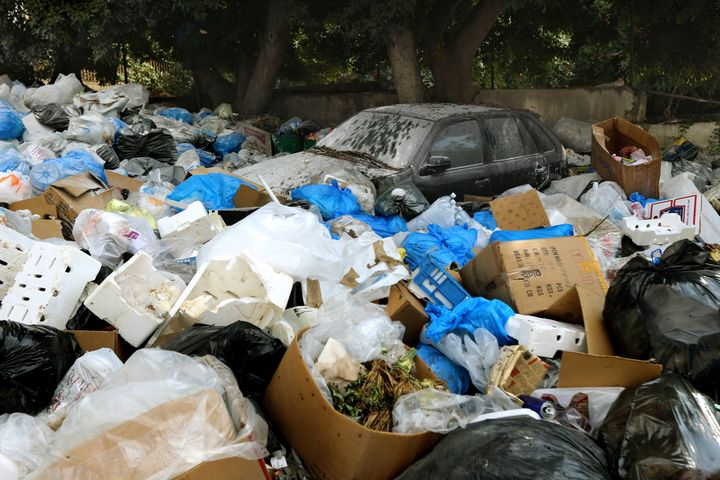 Large amounts of trash surround a car in Beirut, Lebanon, on Aug. 24, 2015.
