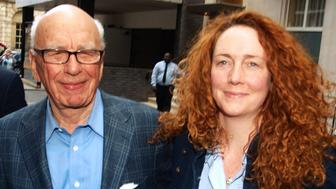Rebekah Brooks (R) Chief Executive of News International and Rupert Murdoch Chairman of News Corporation leave from his London residence shortly after his arrival in  Britain on  July 10, 2011.   Media baron Rupert Murdoch flew into London to take personal charge of the phone-hacking scandal that felled his News of the World tabloid, as Britons rushed to buy the final edition of the paper.   AFP Photo/ Max NASH (Photo credit should read MAX NASH/AFP/Getty Images)