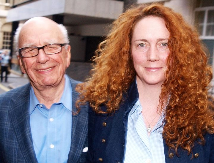 Rebekah Brooks  and Rupert Murdoch Chairman of News Corporation leave from his London residence in Britain on July 10, 2