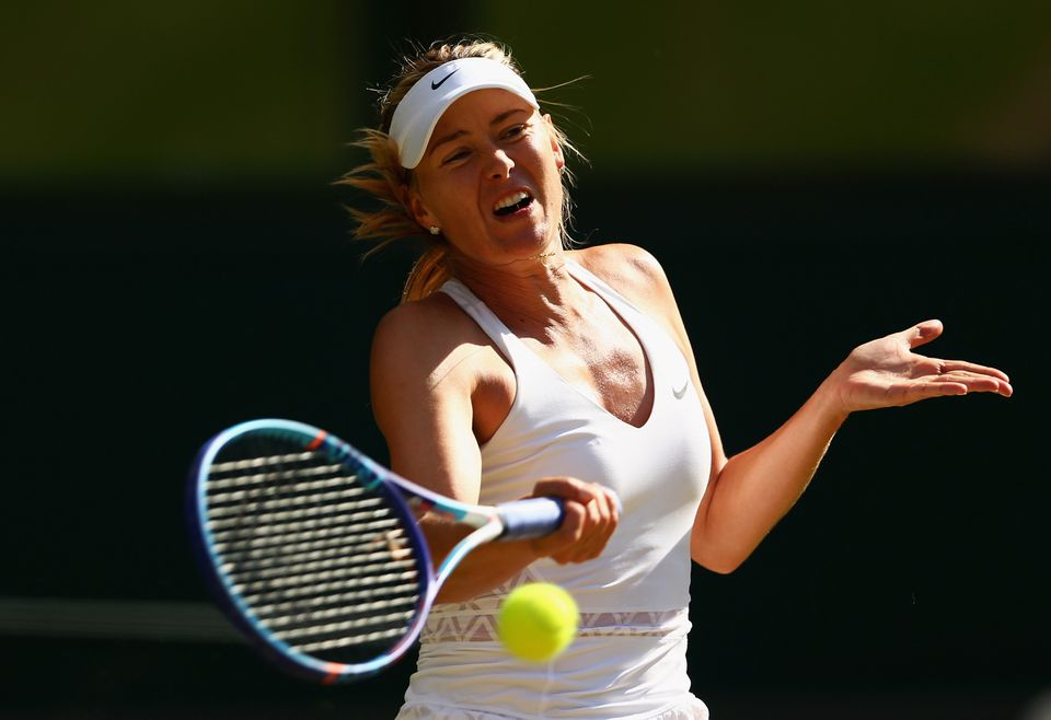 LONDON, ENGLAND - JULY 09:  Maria Sharapova of Russia plays a forehand in the Ladies Singles Semi Final match against Serena