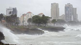 Waves breaking into the seafront in Santo Domingo, Dominican Republic on August 28, 2015. Tropical Storm Erika left at least 12 people dead in its wake when it swept over the island of Dominica on Friday then rolled on to pummel the Dominican Republic. AFP PHOTO / ERIKA SANTELICES        (Photo credit should read ERIKA SANTELICES/AFP/Getty Images)