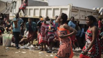<p>Swazi girls get ready to walk to the Royal palace ahead of the traditional reed dance on August 28, 2015 on a farm on the outskirts of Luve, Swaziland. </p>