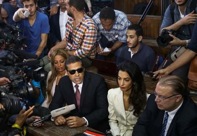 "<span class='image-component__caption' itemprop=""caption"">Canadian-Egyptian Al-Jazeera journalist Mohamed Fahmy (right 3), one of the three reporters sentenced to three year in jail by Egyptian court, his fiancee Marwa Omara (right 4) and lawyer Amal Clooney (right 2) are seen as Fahmy speaks to the media after a court session, in the Tora prison in Cairo, Egypt on August 29, 2015.</span>"