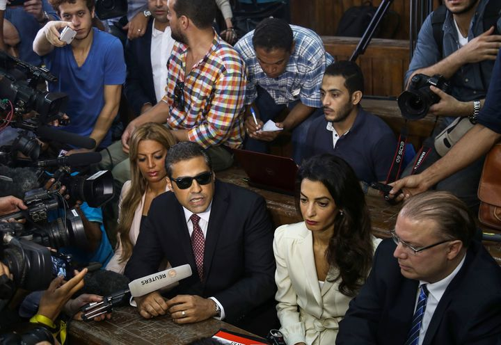 Canadian-Egyptian Al-Jazeera journalist Mohamed Fahmy (right 3), one of the three reporters sentenced to three year in jail b