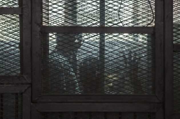 "<span class='image-component__caption' itemprop=""caption"">Al-Jazeera journalists, Canadian Mohamed Fahmy (R) and Egyptian Baher Mohamed (C), both accused of supporting the blacklisted Muslim Brotherhood in their coverage for the Qatari-owned broadcaster, sit in the defendants' cage during their trial in the capital Cairo on August 29, 2015. </span>"