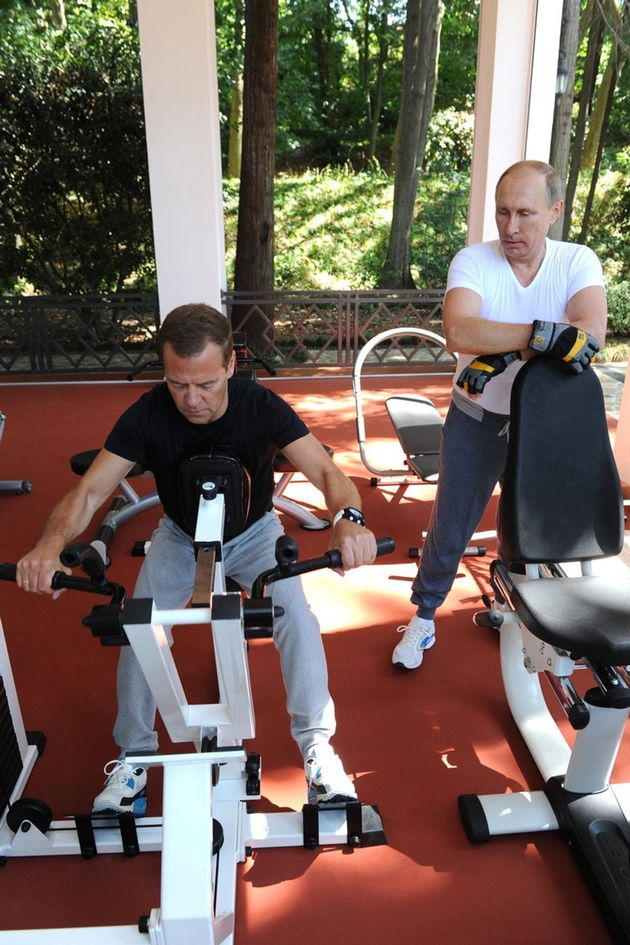 Russias President Vladimir Putin and Russian Prime Minister Dmitry Medvedev work out at a gym at the...