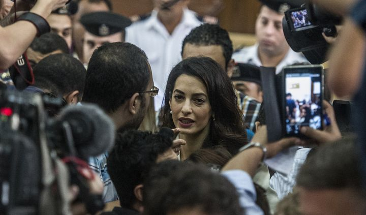 Amal Clooney speaks to reporters during Fahmy'strial on Aug. 29, 2015.