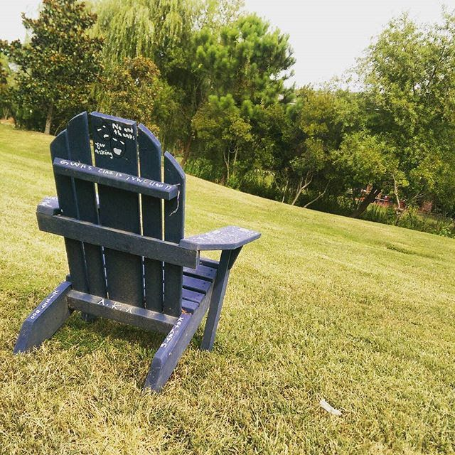 <span>A large wooden chair on Virginia Wesleyan College's Norfolk campus. Jane Doe dropped out of college her sophomore year