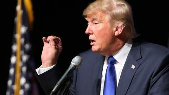 Republican presidential candidate businessman Donald Trump speaks to an audience during a town hall event, Wednesday, Aug. 19, 2015, at Pinkerton Academy in Derry, N.H. (AP Photo/Mary Schwalm)