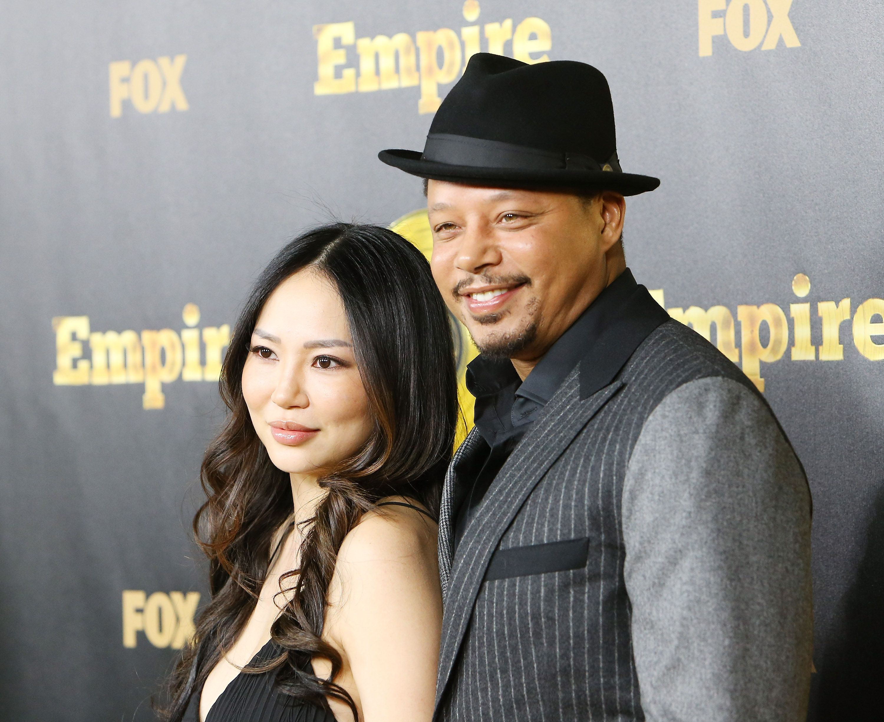HOLLYWOOD, CA - JANUARY 06:  Terrence Howard and his wife, Miranda Howard arrive at the Los Angeles premiere of 'Empire' held at ArcLight Cinemas Cinerama Dome on January 6, 2015 in Hollywood, California.  (Photo by Michael Tran/FilmMagic)