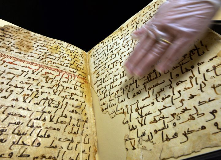 <span>Marie Sviergula, conservator of the University of Birmingham holds a Quran manuscript in Birmingham England on Jul