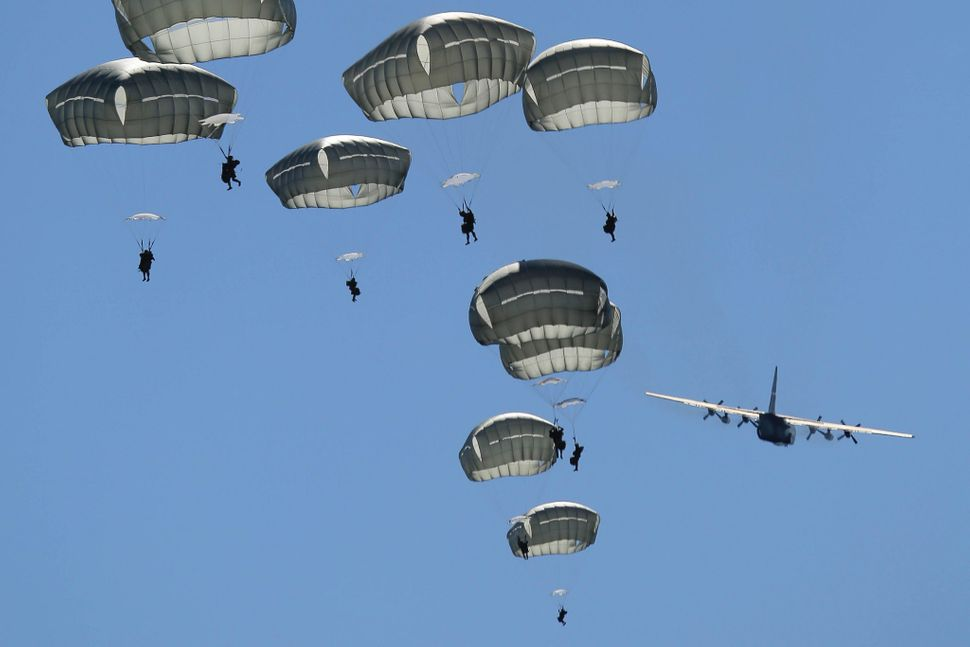 Paratroopers assigned to 1st Battalion (Airborne), 501st Infantry Regiment descend after jumping out of a C-130 Hercules, ass