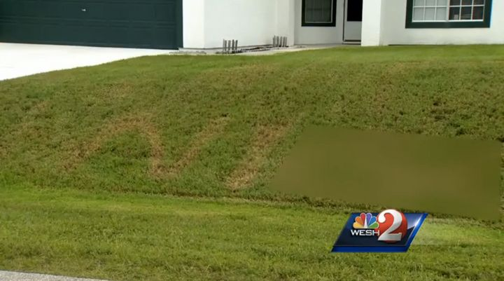 A Florida man found a racial slur burned into his front yard.
