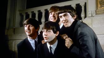 LONDON, ENGLAND - 1964: Rock and roll band 'The Beatles' pose for a portrait wearing suits in circa 1964. (L-R) Ringo Starr, John Lennon, Paul McCartney, George Harrison. (Photo by Michael Ochs Archives/Getty Images)