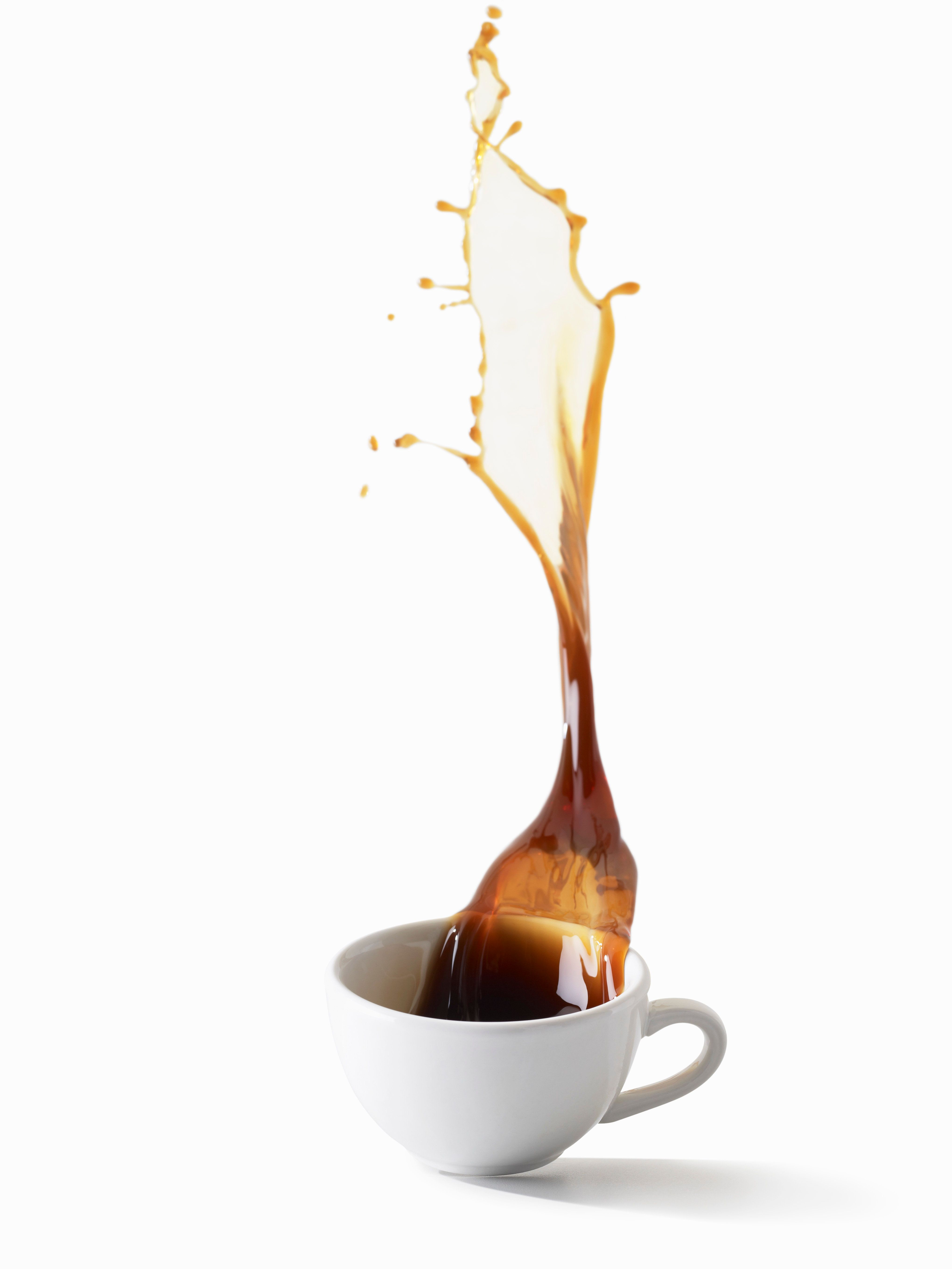 Coffee Spilling out of Coffee Cup
