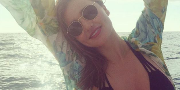 Miranda Kerr Gets Cheeky In A Bikini On The Beach