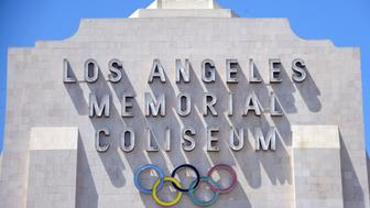 A worker manouevers is vehicle past an entrance to the Los Angeles Coliseum, which played host to the 1932 and 1984 Summer Olympics, in Los Angeles, California on August 31, 2015. The Los Angeles city Council members vote September 1,on the city's bid for the 2024 Olympics in a move seen as an important step toward securing nomination as a candidate by the US Olympic Committee. AFP PHOTO /FREDERIC J.BROWN        (Photo credit should read FREDERIC J. BROWN/AFP/Getty Images)