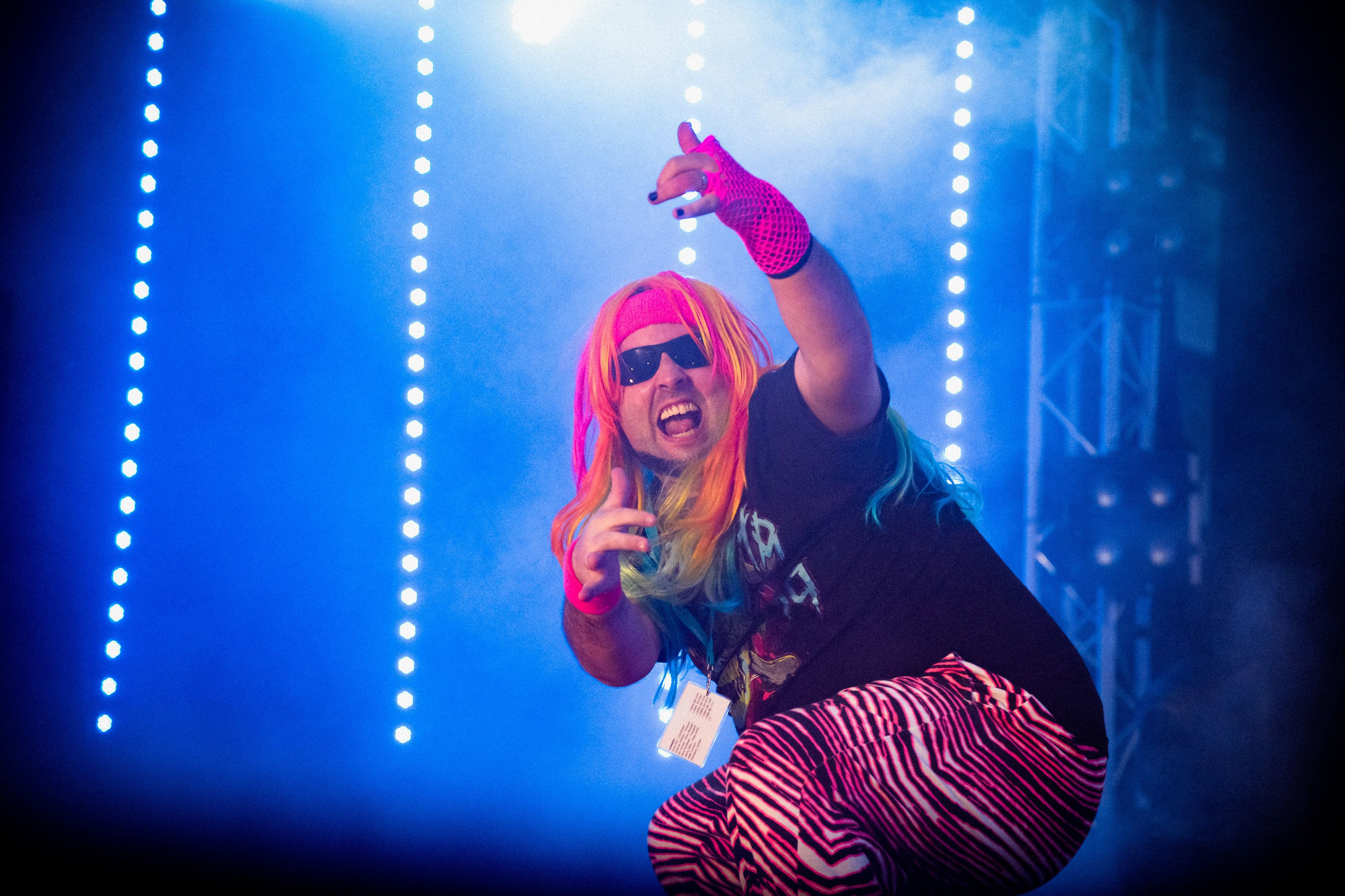 """<span>Tom """"The Wild Thing"""" Wilding performs during the 2015 Air Guitar World Championships.</span>"""