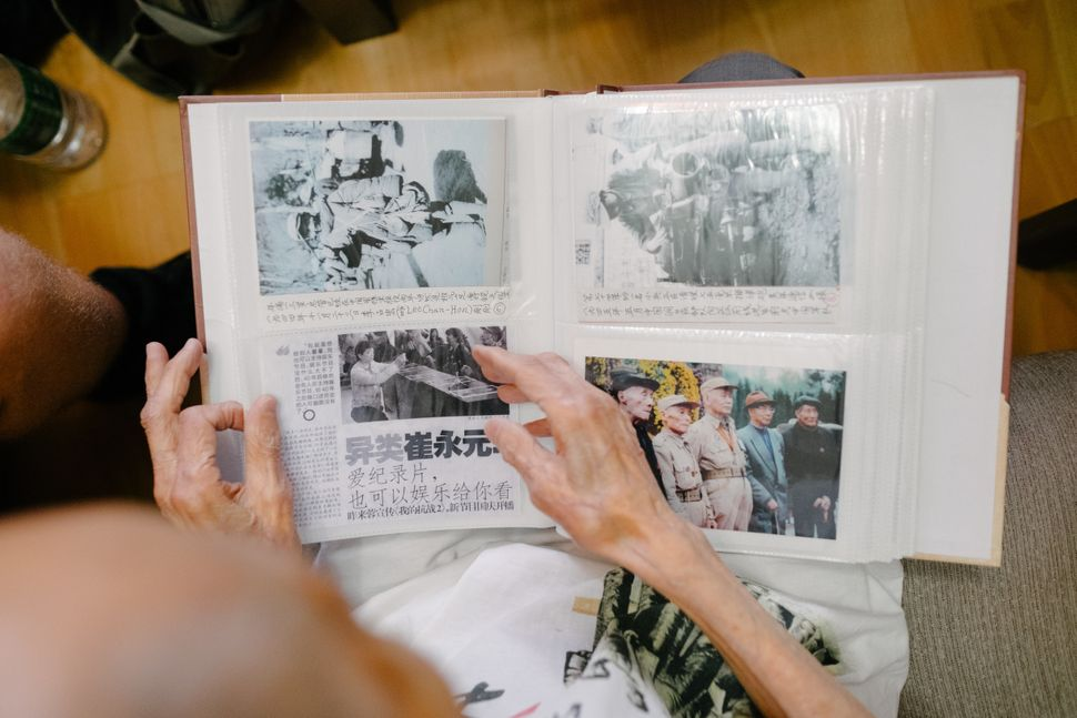 Su Ziliang maintains a scrapbook of war-related news clippings at his home in Chengdu.