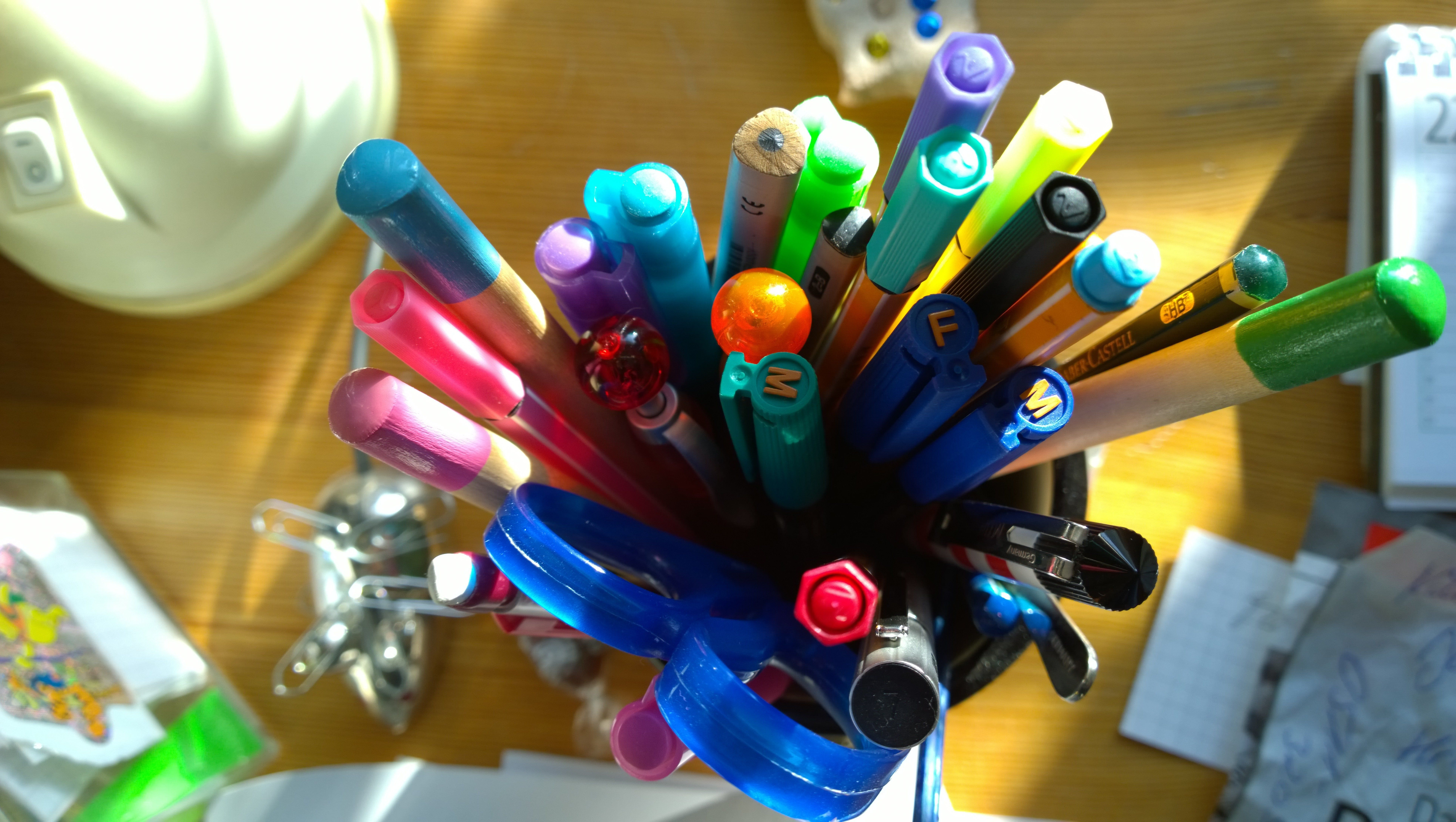 Close-Up Of Pencil Holder In Desk Of Home Office