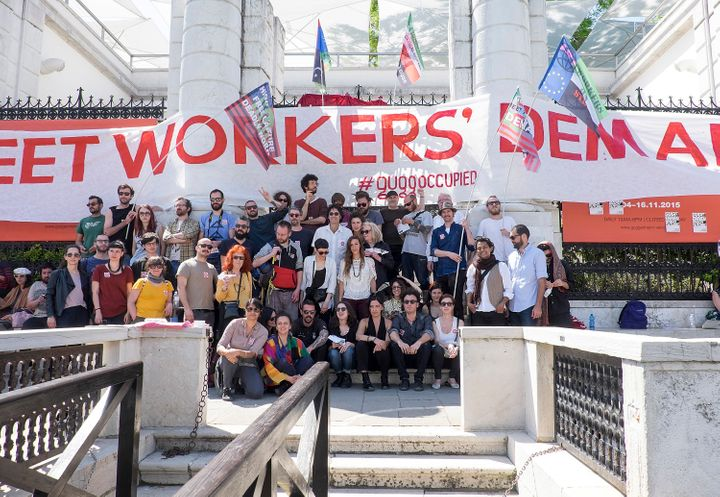 Activists protest outside the Peggy Guggenheim Museum in Venice, Italy, objecting to the conditions of workers building the n