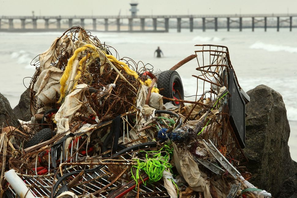 Trash and debris from previous storms accumulate in Seal Beach, California, near the mouth of the San Gabriel River, on Jan.