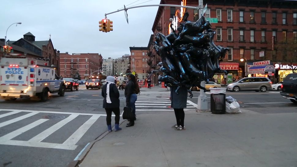 """Sondra Perry's video work is humorous and moving. In '42 Black Panther Balloons on 125th Street,' a cluster of enigmat"