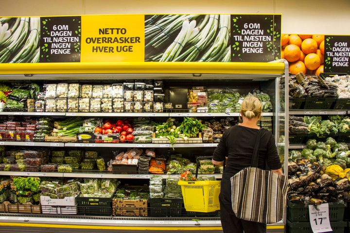 <span>A customer browses a cabinet of fresh vegetables for sale inside a Netto discount store, operated by Danske Supermarked