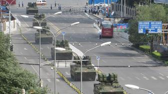<p>Tanks and armored vehicles roll through eastern Beijing on a practice run for the parade.</p>