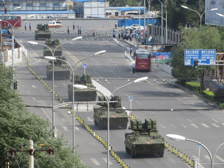 Tanks and armored vehicles roll through eastern Beijing on a practice run for the parade.