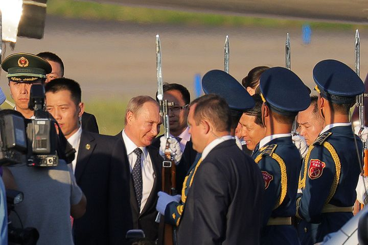 Russian President Vladimir Putin arrives at Beijing International Airport on Wednesday, ahead of attending the V-Day parade f