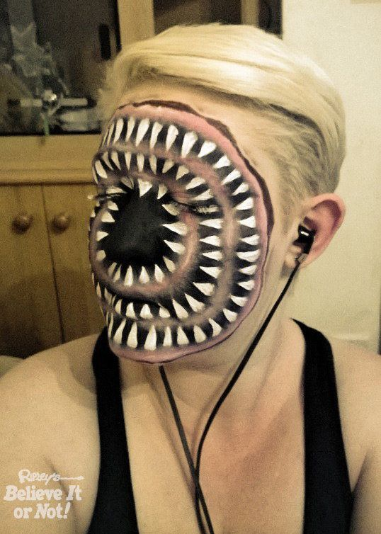 Self-taught mother-of-three Nikki Shelley, from Warwickshire, England, uses face paint to transform herself into scary monste
