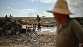 <p>Chinese worker oversees work on a railway track linking Djibouti with Addis Ababa on May 5, 2015.</p>