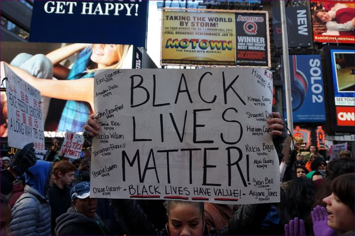 A Black Lives Matter protester holds up a sign during a march in New York City.