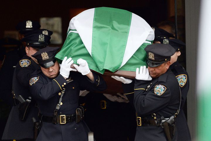 Officers carry the casket of Wenjian Liu, a NYPD officer killed along with his partner, Rafael Ramos, in December 2014.