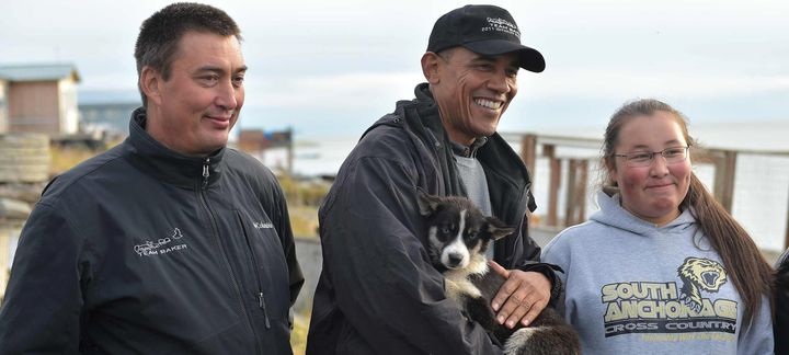 President Barack Obama cuddles with a puppy Wednesday.