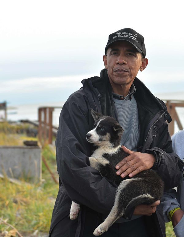 Obama snuggles with a puppy.