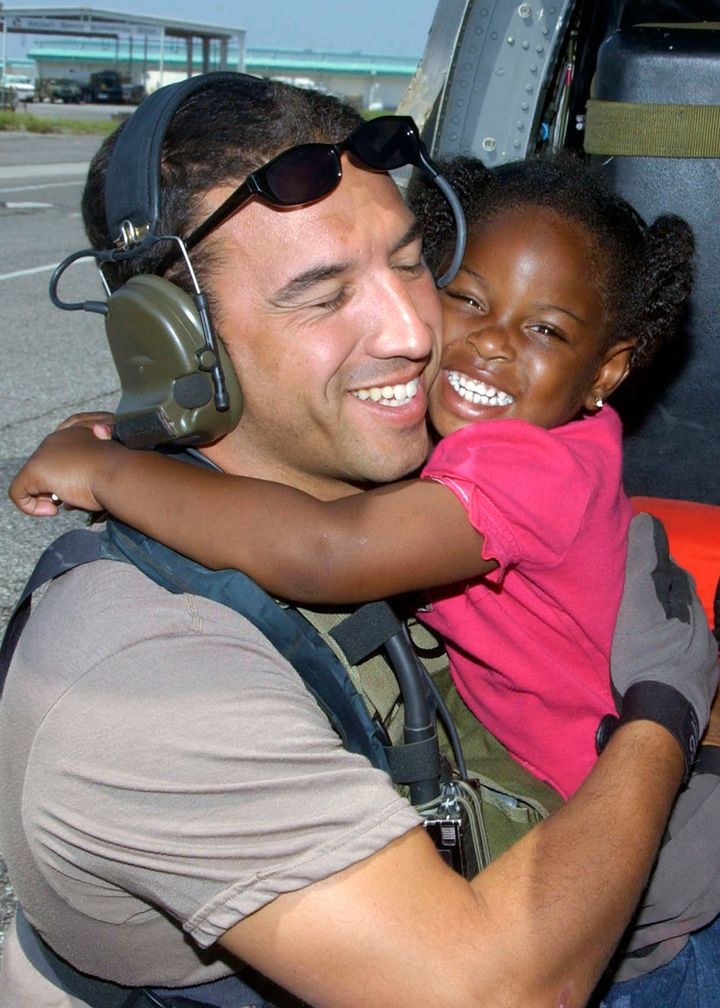Maroney and then-3-year-old LeShay Brown in the iconic photo taken after the girl and her family were rescued.