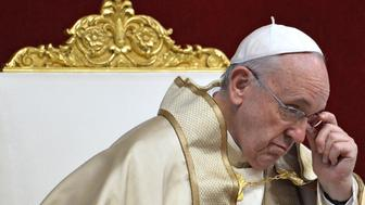 Pope Francis leads a prayer in Saint Peter's basilica in the Vatican, as part of the World Day of Prayer for the Care of Creation, on September 1, 2015. Pope Francis on September 1 called on priests to pardon women who have abortions, and the doctors who perform them, during the upcoming Jubilee year -- overruling hardline traditionalists within the Catholic Church.   AFP PHOTO / ANDREAS SOLARO        (Photo credit should read ANDREAS SOLARO/AFP/Getty Images)
