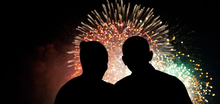 First lady Michelle Obama and President Barack Obama watch fireworks overthe National Mall on Independence Day.