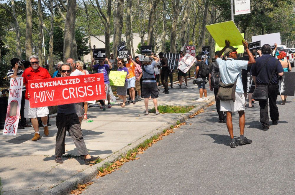 <p>People gathered across from the federal courthouse in Brooklyn on Thursday to protest the raid on Rentboy.com last week.</p>