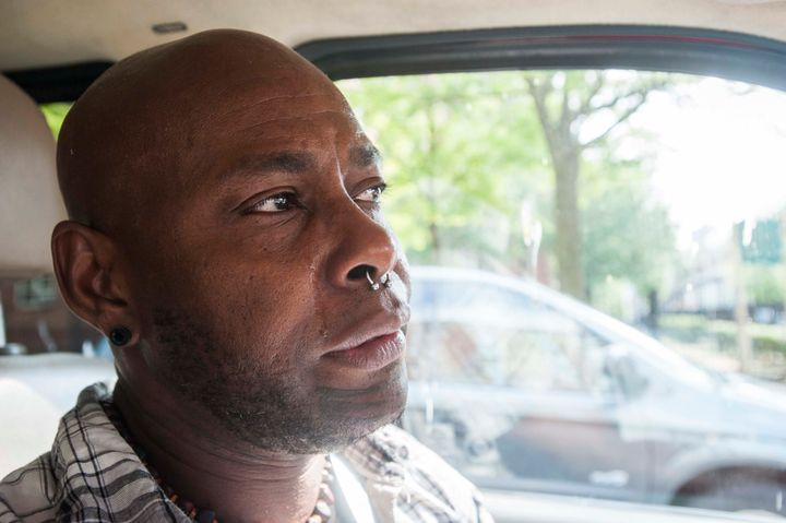 White, driving to his apartment in Harlem, sheds a tear while recounting his story.