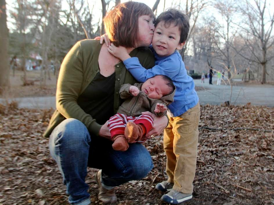 Grandsons Eli (4) and Henry (1 month) snuggle with their grandma, Gina, in Brooklyn's Prospect Park.